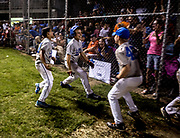 Players from LMH celebrate after scoring a series of runs that gave them the lead in the Shrine Tournament Championship game against Robertson Construction. LMH won the game 9-4.