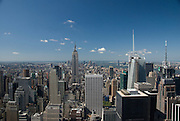 The Empire State Building and the south end of Manhattan as seen on a sunny summer's day from the top of Rockerfeller Center in midtown Manhattan, New York City.