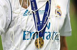 A Real Madrid player with his winners medal after the final whistle during the UEFA Champions League Final at the NSK Olimpiyskiy Stadium, Kiev.