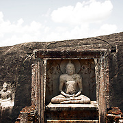 Thanthirimale is an old village in the Anuradhapura District of Sri Lanka. Thanthirimale is known for the ancient Buddhist temple situated in a nearby rock covered area. Thanthirimale is also well known for its Buddha statues. The Samadhi statue carved in a cave is 2.16 metres high. The statue is decorated with the images of two lions and two deities. The stone seat of the Buddha is also ornamented with lion images. Stone pillars in front indicate a structure like a roof, made to cover the statue. There are four roughly marked images on either side of the statue. Experts believe that these unfinished images indicate that the artist had to abandon the task suddenly.