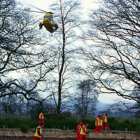 Missing girl...27.12.98.<br /> Tayside Police Search and Rescue team members search the area around Tibbermore as an RAF Sea King searches from above.<br /> <br /> Picture Copyright:  John Lindsay / Perthshire Picture Agency.<br /> 30 James Street, Perth. PH2 8LZ.<br /> Tel. 01738 623350. mobile 07775 852112<br /> (Vat Reg No 716 8222 37).
