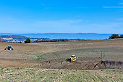 bulldozer flatting hilly agricultural fields in France Languedoc Aude