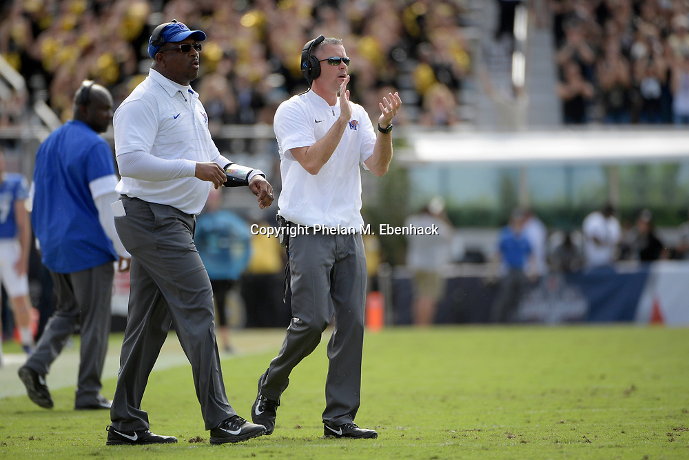 Memphis head coach Mike Norvell, right, applauds after a play during the first half of the American Athletic Conference championship NCAA college football game against Central Florida Saturday, Dec. 2, 2017, in Orlando, Fla. Central Florida won 62-55. (Photo by Phelan M. Ebenhack)