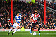 Brentford Forward Oliver Watkins (11) and Queens Park Rangers Midfielder Pawel Wszolek (23) battle for the ball during the EFL Sky Bet Championship match between Brentford and Queens Park Rangers at Griffin Park, London, England on 2 March 2019.
