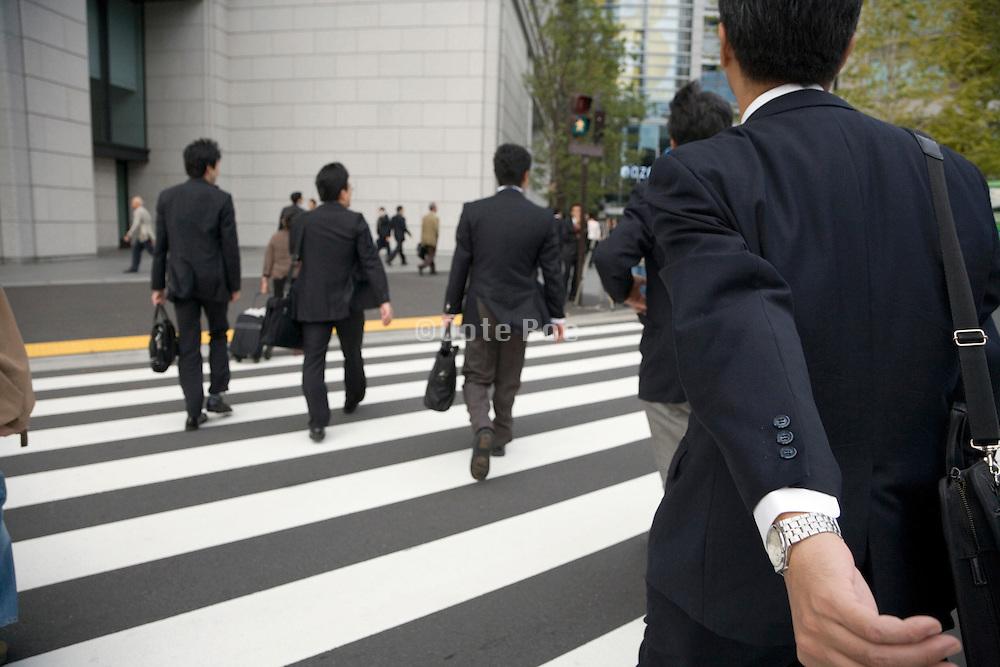 businesspeople rushing across a pedestrian crossing Tokyo Japan