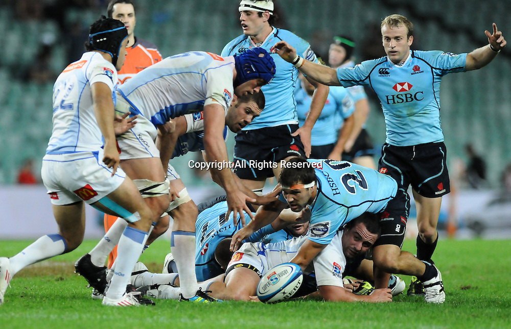 17.03.2012 Sydney, Australia. Force lock Nathan Sharpe and Waratahs Chris Alcock scramble for the loose ball during the FxPro Super Rugby game between the New South Wales Waratahs  and Western Force at the Allianz Stadium,Sydney.