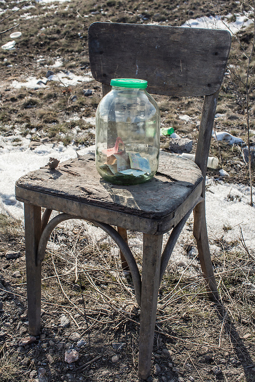 PEREVALSK, UKRAINE - FEBRUARY 20: A jar used for fundraising sits on a chair at a checkpoint guarded by Cossack rebels on February 20, 2015 in Perevalsk, Ukraine. Ukrainian forces withdrew from the nearby strategic and hard-fought town of Debaltseve after being effectively surrounded by pro-Russian rebels, though fighting has caused widespread destruction in the town. (Photo by Brendan Hoffman/Getty Images) *** Local Caption ***