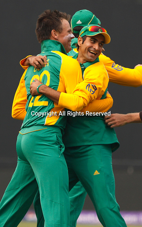 24.02.2011 Cricket World Cup from the Feroz Shah Kotla stadium in Delhi. South Africa v West Indies. Johan Botha of South Africa celebrates the wicket of Chris Gayle during the match of the ICC Cricket World Cup between South Africa and West Indies.