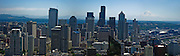 From the Space Needle's observation deck at 520 feet (160 m), visitors see this view of Seattle's downtown buildings and Mount Rainier. .Seattle Center, Seattle, Washington. (Panorama stitched from 4 images.)