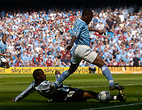 Photo. Glyn Thomas, Digitalsport<br /> NORWAY ONLY<br /> <br /> Manchester City v Newcastle United. <br /> FA Barclaycard Premiership. 01/05/2004.<br /> Newcastle's Titus Bramble (L) slides in to tackle Shaun Wright-Phillips.