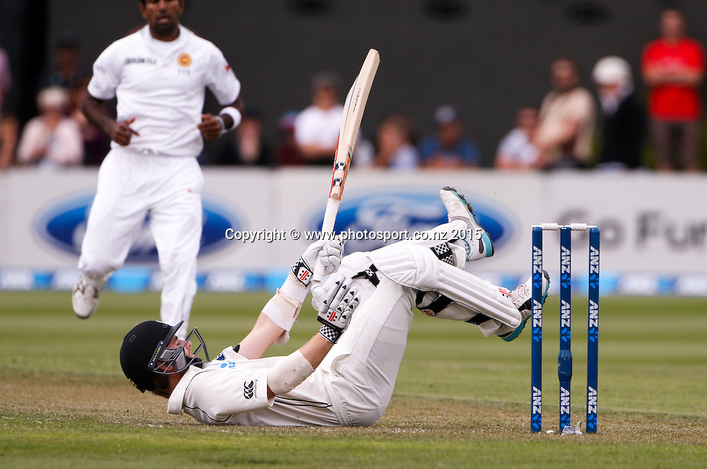 Kane Williamson on the ground.  First day, second test, ANZ Cricket Test series, New Zealand Black Caps v Sri Lanka, 03 January 2015, Basin Reserve, Wellington, New Zealand. Photo: John Cowpland / www.photosport.co.nz