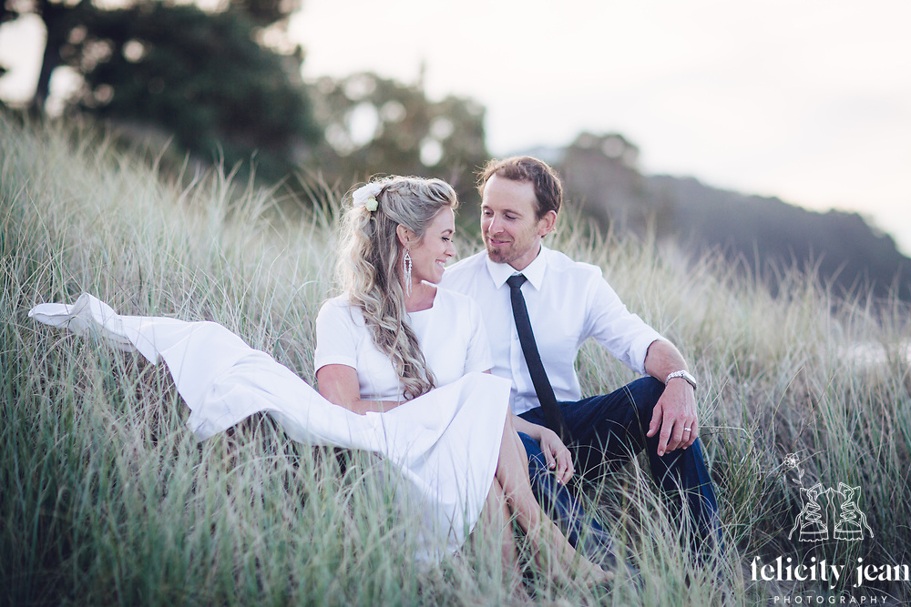 beautiful beach wedding on the coromandel peninsula hahei beach by felicity jean photography