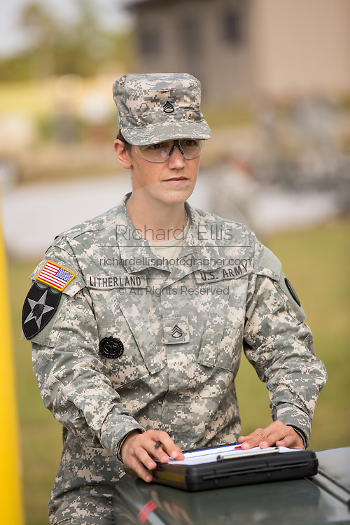A woman Drill Sergeant instructor at the US Army Drill Instructors School Fort Jackson grades Drill Sergeant candidates during training September 26, 2013 in Columbia, SC. While 14 percent of the Army is women soldiers there is a shortage of female Drill Sergeants.