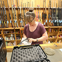 Sherry Crew, Richey's wife, cleans one of many guns that were taken in on trade over the weekend and get them put away for the next business day. The gun shop is open Thursday and Friday from 9-5 and Saturday 9-2.