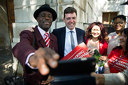 ©  London News Pictures. 19/07/2015. London, UK. ANDY BURNHAM poses for a selfie photograph with supporters as he arrives at the event.  Labour leadership candidates Jeremy Corbyn, Yvette Cooper, Liz Kendall and Andy Burnham attend a hustings at the Camden Centre in London. The new leader is due to be announced in September 2015.  Photo credit: Ben Cawthra/LNP