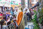 The Three Kings pick up the baby Jesus doll from a nativity crèche during El Dia de Reyes January 6, 2016 in San Miguel de Allende, Mexico. The traditional festival marks the culmination of the twelve days of Christmas and commemorates the three wise men who traveled from afar, bearing gifts for the infant baby Jesus.