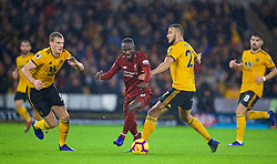 WOLVERHAMPTON, ENGLAND - Friday, December 21, 2018: Liverpool's Naby Keita (C) and Wolverhampton Wanderers' Ryan Bennett (L) and Romain Saïss (R) during the FA Premier League match between Wolverhampton Wanderers FC and Liverpool FC at Molineux Stadium. (Pic by David Rawcliffe/Propaganda)
