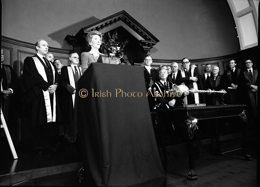 Nancy Reagan .Visits the Royal College Of Surgeons..St Stephens Green,.1984..04.06.1984.06.04.1984.4th June 1984..Nancy Reagan visited the Royal College of Surgeons where she unveilled a portrait of her late father.Her father, Dr Loyal Davis was an Honorary Fellow of the college. Mrs Reagan then presented the portrait to the college..Picture of Mrs Nancy Reagan as she says a few words in relation to the portrait of her father,Dr Loyal Davis. She is backed by the eminent surgeons from the college.