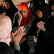 Bedouin women are singing during a bedouin wedding ceremony. They will gather together with other Bedouin tribes for several days. For Bedouins, music and poetry is very important to keep their traditions alive.