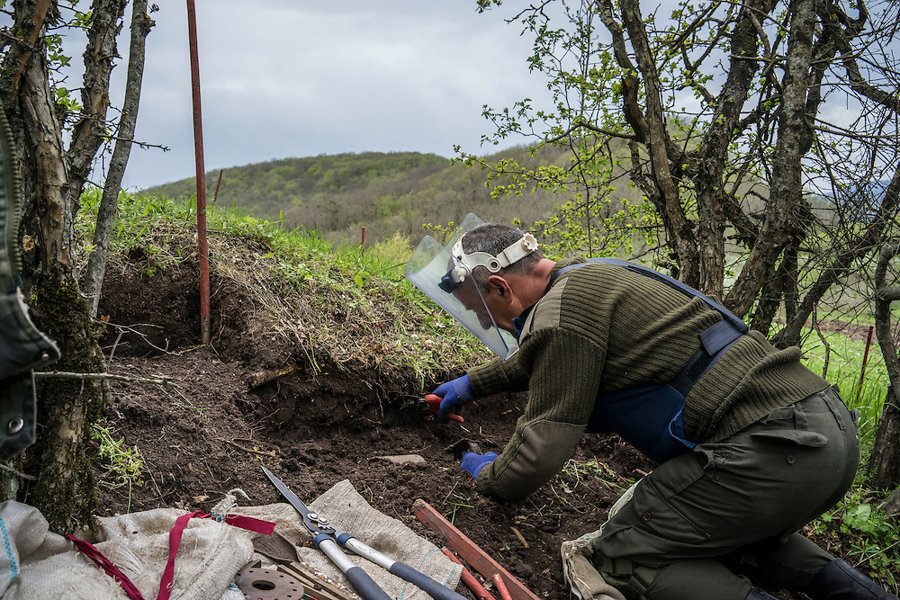 HAGOB KAMARI, NAGORNO-KARABAKH - APRIL 20: A deminer with the charity HALO Trust works to clear a minefield on April 20, 2015 in Hagob Kamari, Nagorno-Karabakh. Since signing a ceasefire in a war with Azerbaijan in 1994, Nagorno-Karabakh, officially part of Azerbaijan, has functioned as a self-declared independent republic and de facto part of Armenia, with hostilities along the line of contact between Nagorno-Karabakh and Azerbaijan occasionally flaring up and causing casualties. (Photo by Brendan Hoffman/Getty Images) *** Local Caption ***