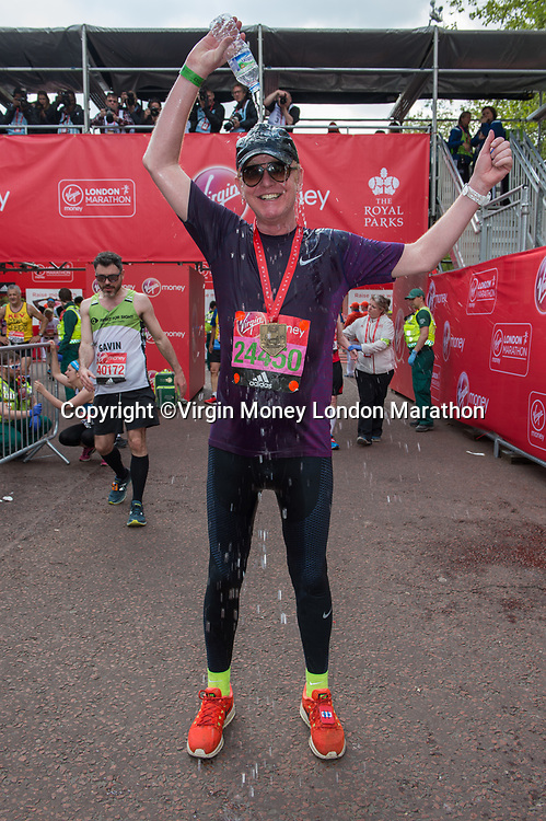 Chris Evans (Radio 2 presenter running for Children In Need) pours a bottle of water over his head just after finishing the race. The Virgin Money London Marathon, 23rd April 2017.<br /> <br /> Photo: Joanne Davidson for Virgin Money London Marathon<br /> <br /> For further information: media@londonmarathonevents.co.uk