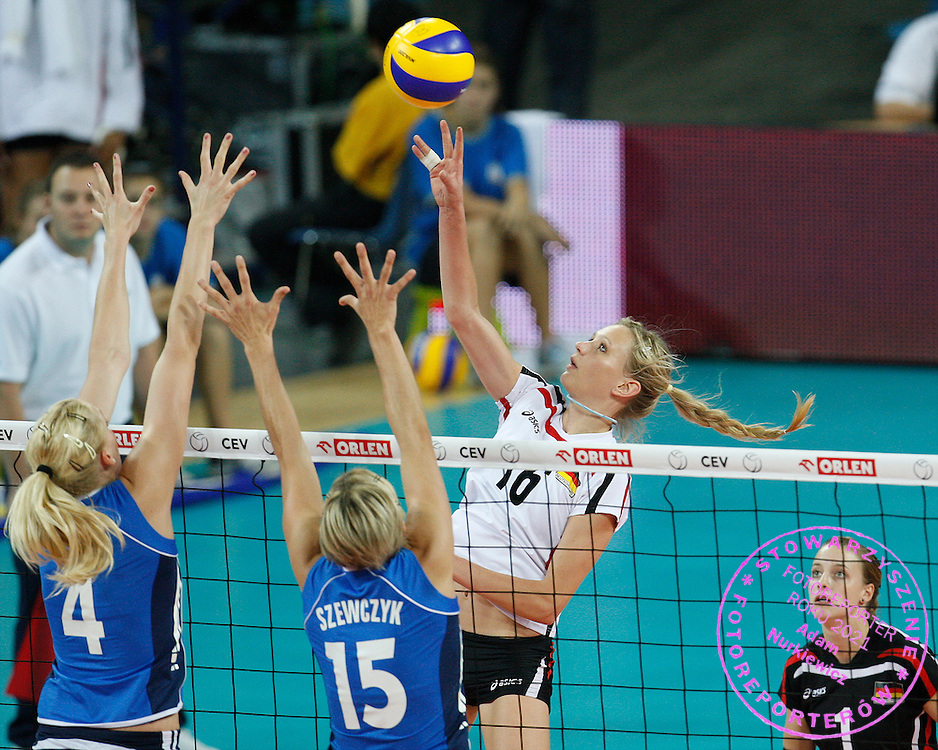WROCLAW 26/09/2009.WOMEN'S EUROPEAN VOLLEYBALL CHAMPIONSHIPS.Margareta Kozuch of Germany spikes as christina Bauer /L/ and Severine Szewczyk of France try to block during the match at the Women's European Volleyball Championships in Wroclaw.PHOTO / PIOTR HAWALEJ / WROFOTO