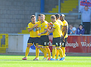 Sean Rigg of AFC Wimbledon (number 11) celebrates scoring the opening goal of the match during the Sky Bet League 2 match at Brunton Park, Carlisle<br /> Picture by Greg Kwasnik/Focus Images Ltd +44 7902 021456<br /> 06/09/2014