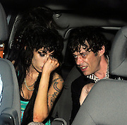 12.SEPTEMBER.2008. LONDON<br /> <br /> AMY WINEHOUSE LEAVING HER HOUSE TO GUEST DJ AT THE MONARCH BAR, CAMDEN. SHE HAD CUTS ON HER ARM, DIRTY HANDS AND PATCHES ON HER FACE, SHE THEN LEFT AT 3.30AM LOOKING VERY DRUNK WITH MICK FROM BABYSHAMBLES HOLDING A GUITAR BEFORE RETURNING HOME.<br /> <br /> BYLINE: EDBIMAGEARCHIVE.CO.UK<br /> <br /> *THIS IMAGE IS STRICTLY FOR UK NEWSPAPERS AND MAGAZINES ONLY*<br /> *FOR WORLD WIDE SALES AND WEB USE PLEASE CONTACT EDBIMAGEARCHIVE - 0208 954 5968*