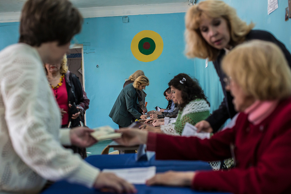HARTSIZK, UKRAINE - MAY 11: Poll workers check in voters at a polling station on May 11, 2014 in Hartsizk, Ukraine. A referendum on greater autonomy is being held after pro-Russian activists took over at least ten cities in the eastern part of the country in a bid for less control from the central government from Kiev. (Photo by Brendan Hoffman/Getty Images) *** Local Caption ***