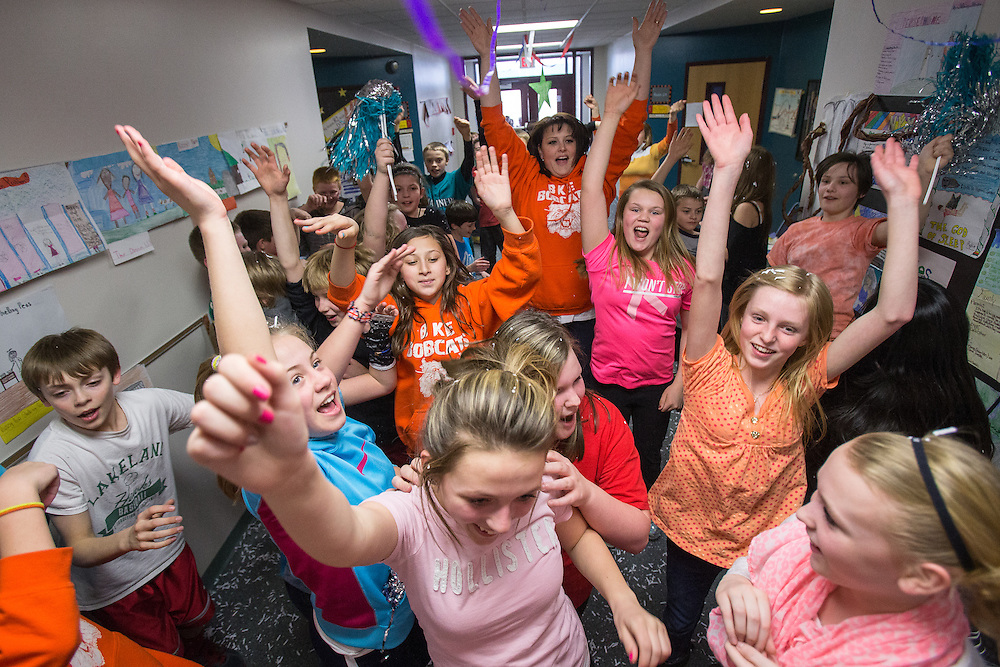 GABE GREEN/Press<br /> <br /> Students and one teacher raise the roof while having a spontaneous dance party Tuesday in a hallway of Betty Kiefer Elementary. The dance party started while students were cleaning up confetti that was left after Betty Kiefer kids and the Lake City High School Student Council teamed up to make a &ldquo;lip dub&rdquo; video to promote Rachel&rsquo;s Challenge.
