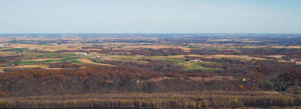 Aerial view of Wisconsin farm lands looking east from the Iowa side of the Mississippi River on a beautiful autumn day. Wisconsin's Nelson Dewey State Park sits atop the bluff on the east side of the river, just north of Casseville, Wisconsin.