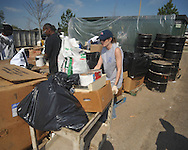 Kim Holmes of Three Rivers works the Household Hazardous Waste Collection Day at the Oxford Conference Center in Oxford, Miss. on Saturday, April 9, 2011.