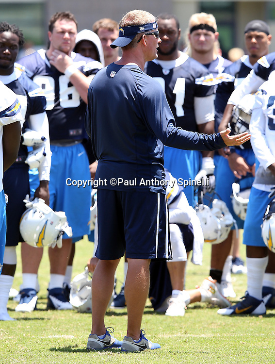 San Diego Chargers head coach Mike McCoy gestures as he talks to players during the San Diego Chargers Spring 2015 NFL minicamp practice on Wednesday, June 17, 2015 in San Diego. (©Paul Anthony Spinelli)