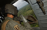 Colombian government coca verification flight from Tumaco airfield east into the jungle of Nari&ntilde;o.<br />Flying in a Colombian army Blackhawk helicopter, with an escort of three Huey helicopter gunships. Using GPS devices, Colombian authorities verify the presence of coca farms deep in the leftist-guerilla FARC-held jungle.<br />In each area visited extensive coca cultivation was found. This is 'hot' mission needing to fly low for visual verification. On the previous day the helicopter was hit twice by FARC ground-fire.