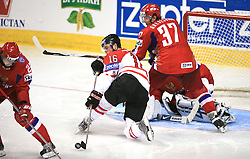 Jonathan Toews (16) of Canada between Konstantin Korneyev (22) of Russia and Denis Grebeshkov (37) of Russia at  ice-hockey game Canada vs Russia at finals of IIHF WC 2008 in Quebec City,  on May 18, 2008, in Colisee Pepsi, Quebec City, Quebec, Canada. Win of Russia 5:4 and Russians are now World Champions 2008. (Photo by Vid Ponikvar / Sportal Images)