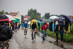 Rain, people and local cyclist at sector 9 de Gruson au Carrefour de l'Arbre, Tour de France, Stage 5: Ypres > Arenberg Porte du Hainaut, UCI WorldTour, 2.UWT, Gruson, France, 9th July 2014, Photo by Pim Nijland
