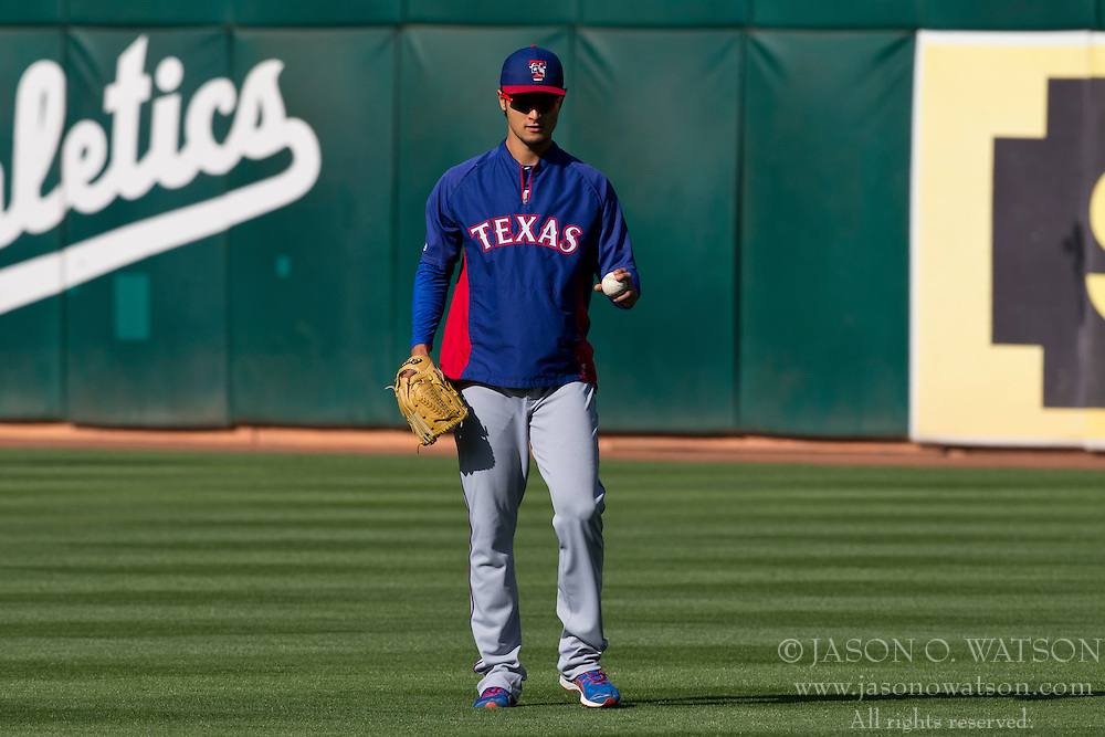 OAKLAND, CA - MAY 14:  Yu Darvish #11 of the Texas Rangers stands in the outfield during batting practice before the game against the Oakland Athletics at O.co Coliseum on May 14, 2013 in Oakland, California. The Texas Rangers defeated the Oakland Athletics 6-5 in 10 innings. (Photo by Jason O. Watson/Getty Images) *** Local Caption *** Yu Darvish