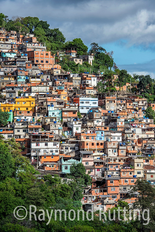 Brasil- Rio de Janeiro- View of the city Rio de Janeiro. Favela's - A favela (Portuguese pronunciation: [faˈvɛlɐ]) is a slum in Brazil within urban areas. The first favelas appeared in the late 19th century and were built by soldiers who had nowhere to live. Some of the first settlements were called barrios africanos (African neighbourhoods). Over the years, many former enslaved Africans moved in. Favela in rio de janeiro. photo raymond rutting