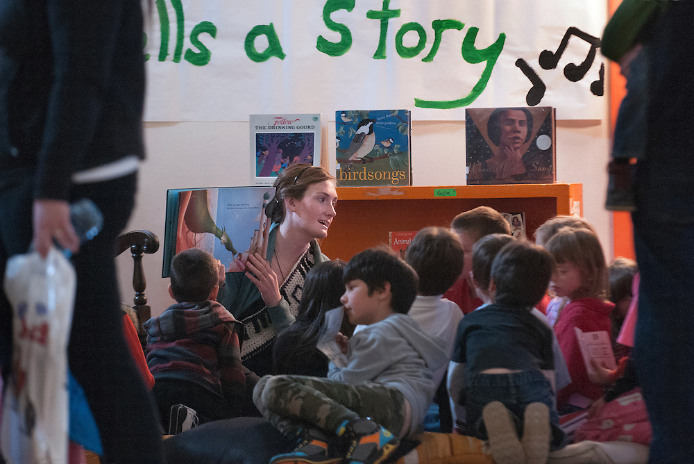 "em040314j/a1/Katherine Keener, the music teacher at Atalaya Elemtary, sings a story to a group kids. The PTA and teachers at Atalaya Elementary School held a Story Jam in the gym of their temporary location at the Kaune building in Santa Fe Thursday evening. Students were treated to several stories told by people ranging from professional story tellers and authors to teachers and parents. Atalaya Elementary is a Title 1 school with at least 40% of the kids recieving free lunch or are considered ""disadvantaged"". Story Jam not only offered kids a chance to hear some stories but also book making, crafts and books to take home. And parents got an opportunity to attend classes to help their young students improve their literacy skills. This was the first Story Jam but the school hopes to make it an annual event. Eddie Moore/Albuquerque Journal"