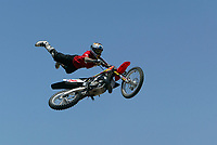 Jul 01, 2003; Anaheim, California, USA; Moto X star athlete MIKE METZGER executing a tremendous stunt feet free with a full sized motobike over at the opening of Disney's California Adventure &quot;X Games Experience&quot;.  Disney park has built two X-Arena's specifically for this 41 day event highlighting extreme sports for the launch of the 2003 ESPN X Games.<br />