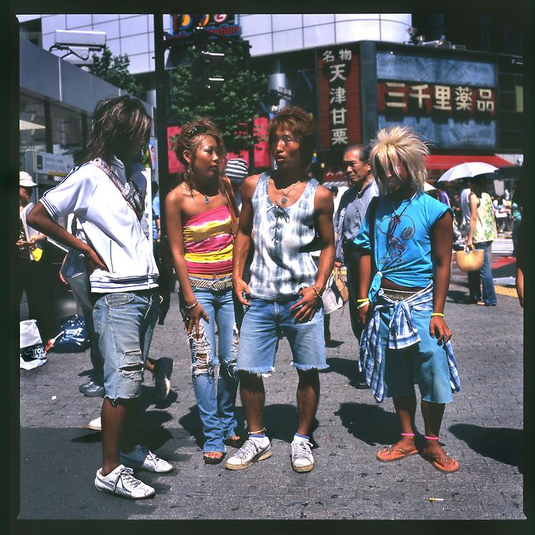 "Gal-O, Kenichi Inagaki and his ""ko-gal"" girlfriend Misaki, meet with his gal-O friends on the street in Shibuya, Tokyo, Japan."