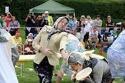 © Licensed to London News Pictures. 31/05/2014<br /> Joan Buce from team DilliGaf<br /> World Custard Pie Championships at Coxheath Heath Village,Coxheath,Kent.<br /> Photo credit :Grant Falvey/LNP