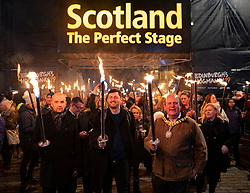 Edinburgh 's Hogmanay Torchlight Procession  Pictured  l-r) Ben Macpherson, Minister for Europe, Migration and International Development, Cammy Day, Deputy Leader City of Edinburgh Council and Frank Ross, The Lord Provost of Edinburgh