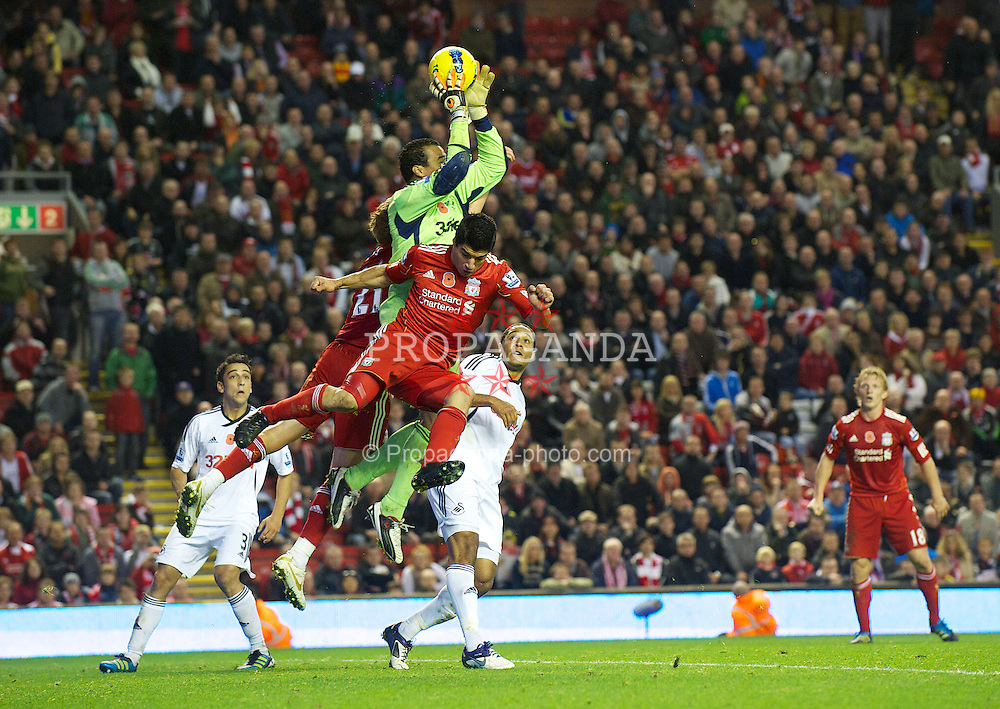 LIVERPOOL, ENGLAND - Saturday, November 5, 2011: Liverpool's Lucas Leiva and Luis Alberto Suarez Diaz challenge Swansea City's goalkeeper Michael Vorm during the Premiership match at Anfield. (Pic by David Rawcliffe/Propaganda)