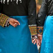 Elderly Bunun tribeswomen hold hands, Annual Bunun Ear Festival, Maya village, Ming Chuan, Namasiya Township, Kaoshiung County, Taiwan