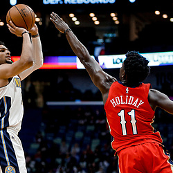 Dec 6, 2017; New Orleans, LA, USA; Denver Nuggets guard Jamal Murray (27) shoots over New Orleans Pelicans guard Jrue Holiday (11) during the first quarter at the Smoothie King Center. Mandatory Credit: Derick E. Hingle-USA TODAY Sports