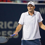 August 21, 2014, New Haven, CT:<br /> Andy Roddick reacts during the Men's Legends Event on day seven of the 2014 Connecticut Open at the Yale University Tennis Center in New Haven, Connecticut Thursday, August 21, 2014.<br /> (Photo by Billie Weiss/Connecticut Open)