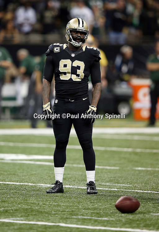 New Orleans Saints outside linebacker Junior Galette (93) looks on between plays during the NFL week 8 regular season football game against the Green Bay Packers on Sunday, Oct. 26, 2014 in New Orleans. The Saints won the game 44-23. ©Paul Anthony Spinelli