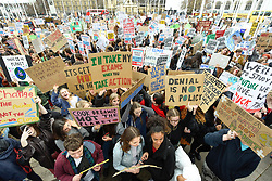 © Licensed to London News Pictures. 15/03/2019. LONDON, UK.  Thousands of students take part in a Climate Change strike in Parliament Square, marching down Whitehall to Buckingham Palace.  Similar strikes by students are taking part around the world demanding that governments take action against the effects of climate change.  Photo credit: Stephen Chung/LNP