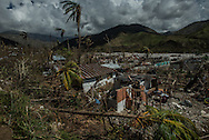 RENDEL, HAITI - OCTOBER 12, 2016: Destroyed homes in Rendel, Haiti. The lessons of wasted aid, and its duplicative and disorganized delivery, have grounded the government's belief that what is done this time must be sustainable.  For instance, people flooded into the capital after the earthquake. This time, Mr. Privert said, the government is determined to keep communities where they are.  Fields would be re-sown, homes repaired, and towns and villages recapitalized, he said. If not, Haitians would be left once more with empty water bottles instead of systems to pump fresh water, slums in lieu of repopulated neighborhoods, and food donations in place of better farming.